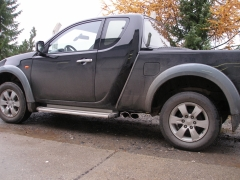 Escape final Mitsubishi L200 KAOT Clubcap doors final silencer sidepipe 2x115x85 Tipo 38 on drivers side Fox